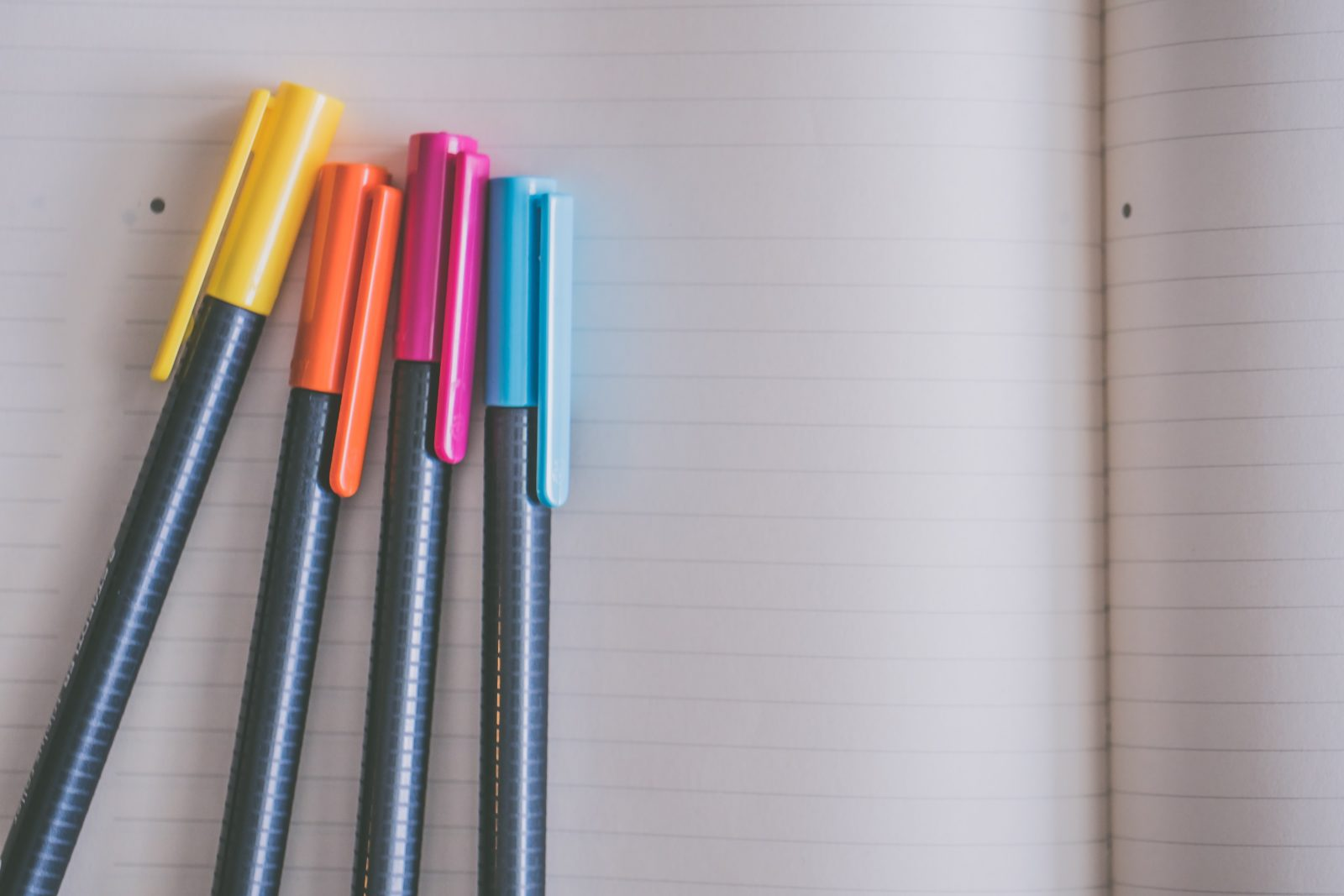 Coloured Editing Pens on Lined Notepaper
