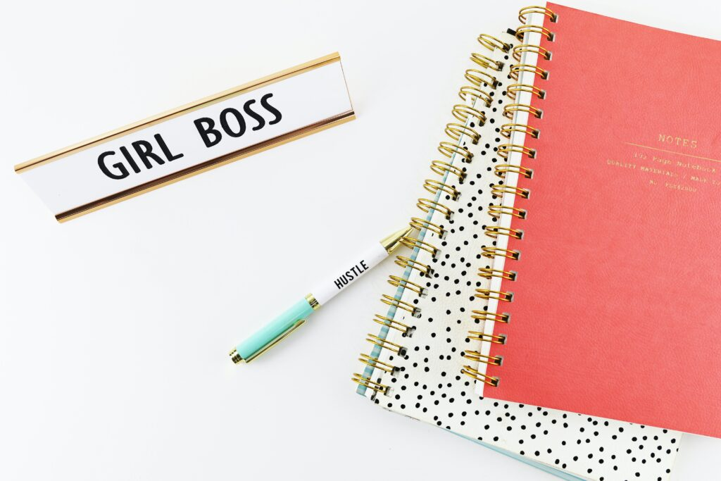 "image of a desk with a ""girl boss"" plaque"